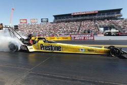 Spencer Massey does his burnout in the Prestone / Fram Top Fuel Dragster