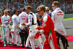 Kimi Raikkonen, Ferrari as the grid observes the national anthem