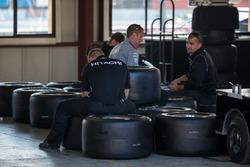 Penske engineers with tires