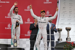 Race winner Nico Rosberg, Mercedes AMG F1 (Right) celebrates on the podium with third placed team mate Lewis Hamilton, Mercedes AMG F1