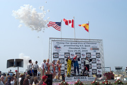Podium: race winner Paul Tracy with A.J. Allmendinger and Oriol Servia