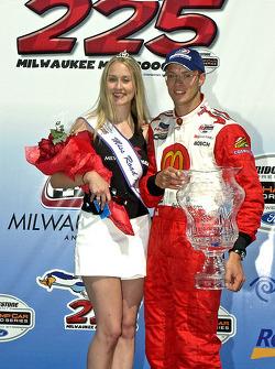 Podium: Race winner Sébastien Bourdais poses with Miss Milwaukee Mile