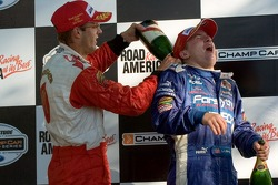 Podium: champagne for A.J. Allmendinger and Sébastien Bourdais