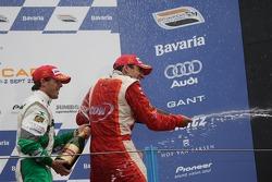 Podium: champagne for Justin Wilson and Jan Heylen