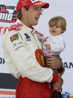 Podium: race winner Sébastien Bourdais celebrates with daughter Emma