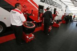 Bridgestone crew members prepare tires