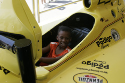 A young fan tries racing sim