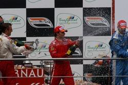 Podium: race winner Sébastien Bourdais with Bruno Junqueira and Graham Rahal