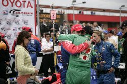 Race winner Dario Franchitti celebrates with Tony Kanaan