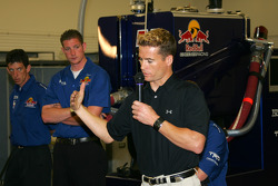Red Bull Cheever Racing driver Alex Barron explains a driver's role in a fast pit stop to the media