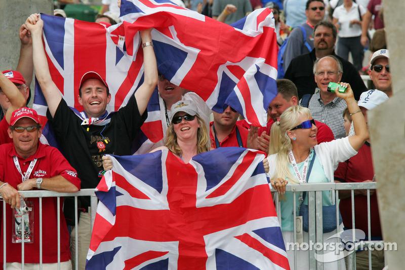 Fans of Dan Wheldon celebrate
