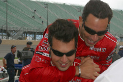 Helio Castroneves celebrates with Sam Hornish Jr.