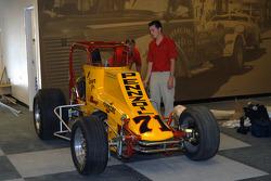 Al Unser III helps father Al Unser, Jr. move his Nance sprint car
