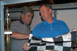 Al Unser, Sr. and Jr. sift through artifacts in the archive room