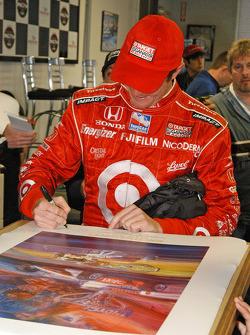Scott Dixon signs posters