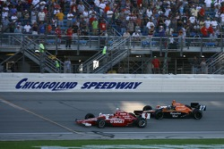 Scott Dixon leads Dario Franchitti with one lap to go