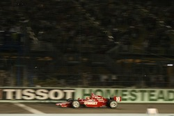 Dan Wheldon takes the checkered flag