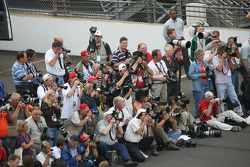 Photographers take pictures of Dario Franchitti