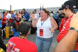 Dan Wheldon and Helio Castroneves help a man propose