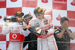 Podium: second place, Lewis Hamilton, McLaren Mercedes, third place Jenson Button, McLaren Mercedes