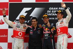 Podium: race winner Sebastian Vettel, Red Bull Racing, second place, Lewis Hamilton, McLaren Mercedes, third place Jenson Button, McLaren Mercedes