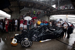 Paul Tracy, Dreyer & Reinbold Racing heads back to Gasoline Alley during the heavy rainstorm