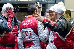 Benoit Tréluyer is congratulate by Marcel Fässler after his pole winning lap
