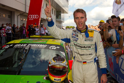 Race winner Timo Bernhard celebrates in parc ferme