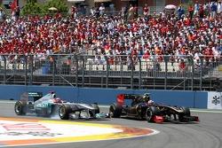 Michael Schumacher, Mercedes GP Petronas and Vitaly Petrov, Lotus Renault F1 Team