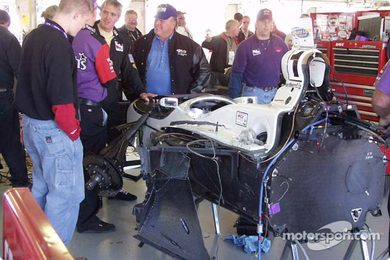 A.J. Foyt and Eddie Cheever discuss the remains of Greg Ray's car