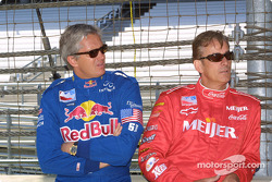 Eddie Cheever and Arie Luyendyk talking before six previous winners take the first lap around the speedway during opening day for the 86th running of the Indy 500