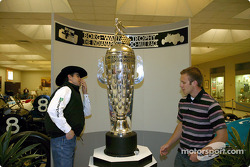 Michael Gaffney inspects the Borg-Warner Trophy with Indianapolis 500 rookie Ed Carpenter