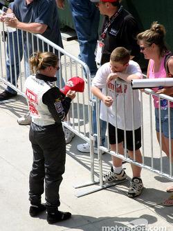 Sarah Fisher signs autographs