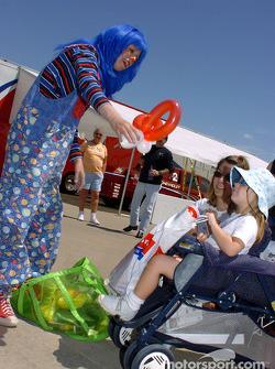 A clown entertains fans