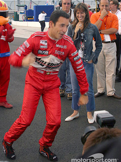 Helio Castroneves celebrates getting the pole