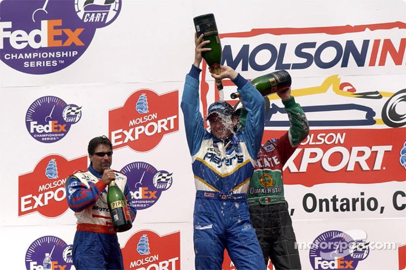 The podium: Michael Andretti looking at Adrian Fernandez and Alex Tagliani