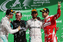 The podium (L to R): Nico Rosberg, Mercedes AMG F1, second; Tony  Walton, Mercedes AMG F1 Mechanic; Lewis Hamilton, Mercedes AMG F1, race winner; Sebastian Vettel, Ferrari, third