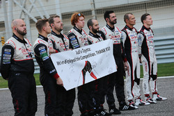 The Toyota Racing team display a message to Audi on the grid