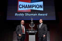 Tim Nelson, Director of Motorsports, Federal-Mogul Motorparts, and Jack Roush, Roush Fenway Racing, pose with the Buddy Shuman Award during the NASCAR NMPA Myers Brothers Awards Luncheon