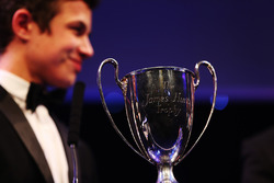 Lando Norris is presented with the British Club Driver of the Year trophy
