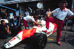 McLaren chief designer John Barnard stands by a McLaren MP4/1B Ford