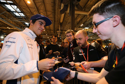 Lance Stroll signs autographs for fans