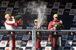 Podium: race winner Shane van Gisbergen, Triple Eight Race Engineering Holden, second place Fabian Coulthard, Team Penske Ford, third place James Courtney, Holden Racing Team
