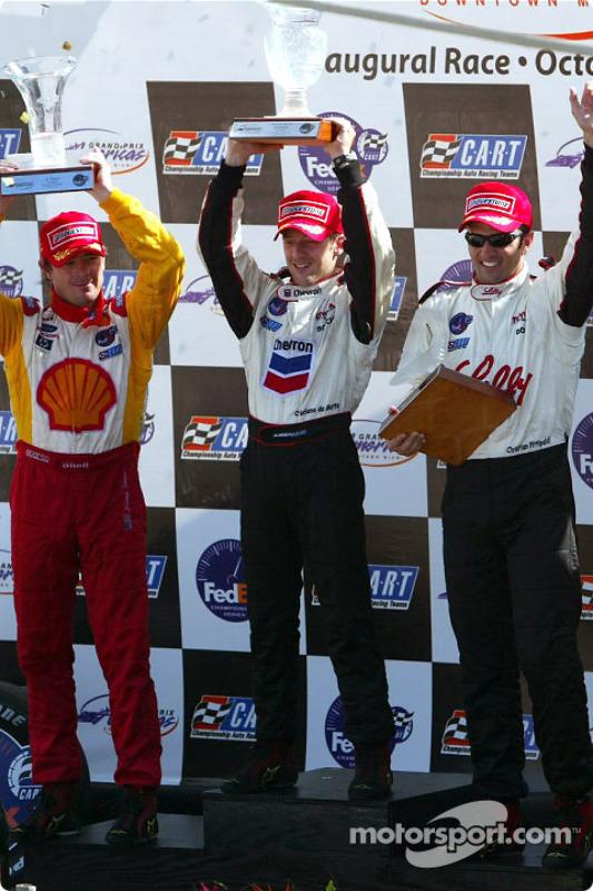 The podium: race winner and 2002 CART Champion Cristiano da Matta with Christian Fittipaldi and Jimm