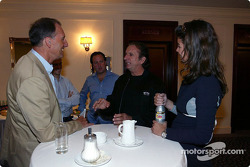 Emerson Fittipaldi talks with members of the media