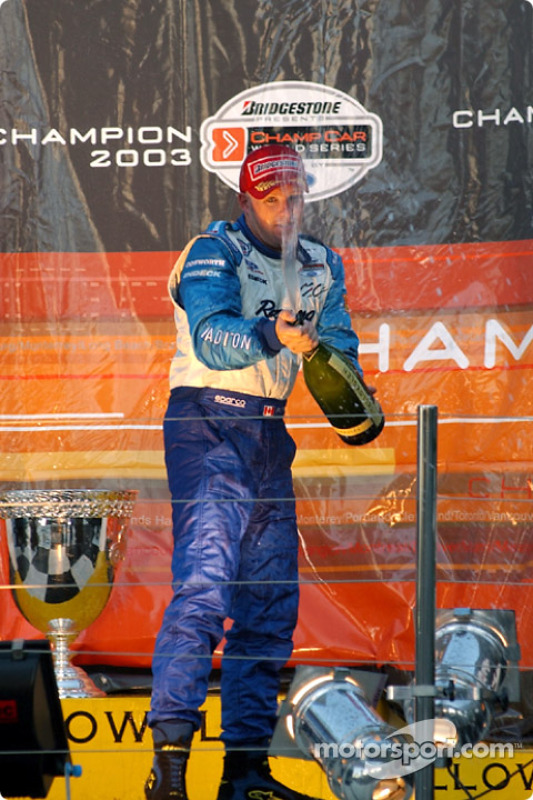 Podium: champagne for 2003 Champ Car champion Paul Tracy