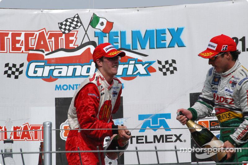 Podium: champagne for race winner Sébastien Bourdais and Mario Dominguez