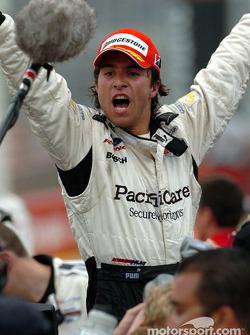 Race winner Bruno Junqueira celebrates