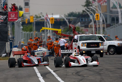 Esteban Guerrieri, Sam Schmidt Motorsports leads Stefan Wilson, Andretti Autosport out of pitlane as safety crew work on cleaning the track