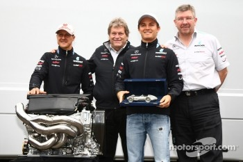 Nico Rosberg, Mercedes GP F1 Team celebrates his 100th race with Michael Schumacher, Mercedes GP F1 Team, Ross Brawn Team Principal, Mercedes GP and Norbert Haug, Mercedes, Motorsport chief